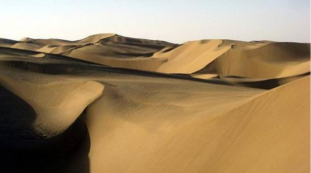 The Taklamakan desert's dry conditions aided in preserving the mummies and artifacts within the Xiaohe cemetery