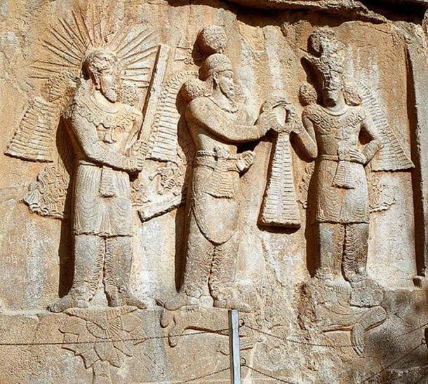Taq-e Bostan: high-relief of Ardeshir II investiture; from left to right: Mithra, Shapur II, Ahura Mazda. Lying down: dead Roman emperor Julian.
