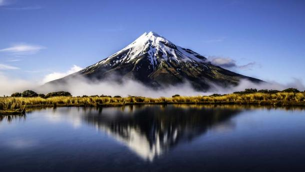 Mount Taranaki in New Zealand is a dormant volcano and an emblematic part of the landscape. Rūaumoko, the god of earthquakes and volcanos, is said to be the unborn child of Rangi and Papa. (M / Adobe Stock)