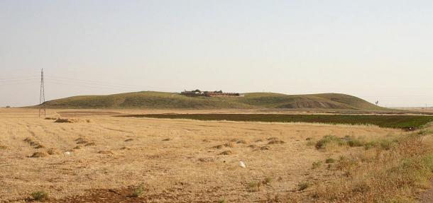 View of Tell Mozan (northeast Syria), ancient Urkesh, from the north. The dighouse can be seen in the middle of the tell.