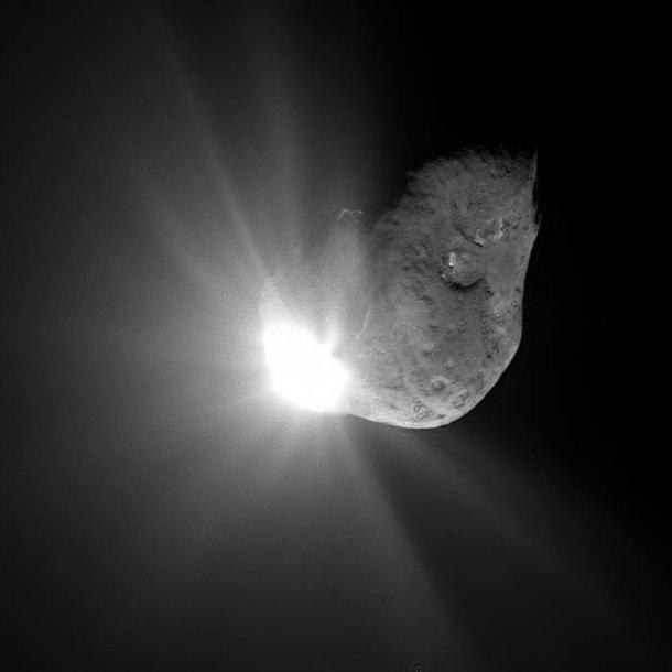 Comet 'Tempel 1' passed close to the Sun and warmed up, releasing gases in a process known to astronomers as outgassing, which produces a visible coma and sometimes a tail. (Public Domain)