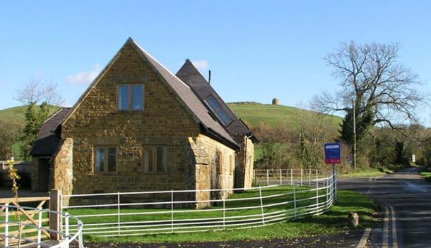 The Templar's chapel at Temple Herdewyke, now converted into a house, with the Phoenix Beacon on the hill behind.