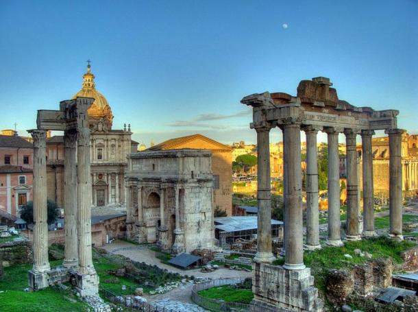 Ruins of the Temple of Saturn (eight columns to the far right), with three columns from the Temple of Vespasian and Titus (left) and the Arch of Septimius Severus (center).