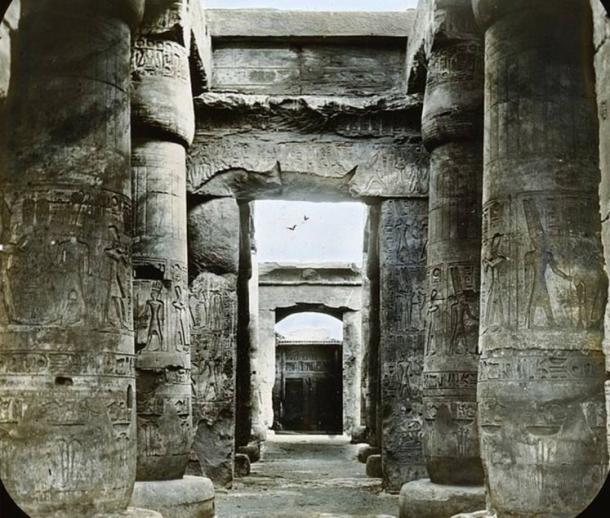 Tall and Imposing, highly decorated pillars line the Temple of Seti I, in Abydos, Egypt.
