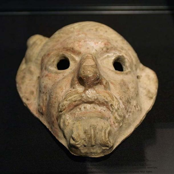 Terracotta mask of the head of German with Suebian knot hairstyle. Two holes for the eyes and two bore holes at the ears for fixing the mask. Whitely yellowish clay with residues of white and red colors. British Museum London, Blacas-Collection. Probably originating from Italy. Dating to 2nd Century AD. (Bullenwächter/CC BY 3.0)