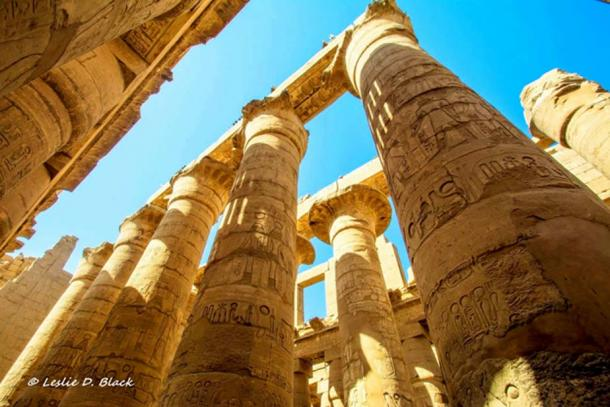 The 134 gigantic columns in the Great Hypostyle Hall at Karnak Temple complex stand testament to a glorious bygone age when it was a pilgrimage spot for over two millennia. A clump of 12 open papyrus capitals here may have been intended to symbolize the primordial 'mound of creation'. This was the abode of the state god, Amun-Ra. Modern-day Luxor.