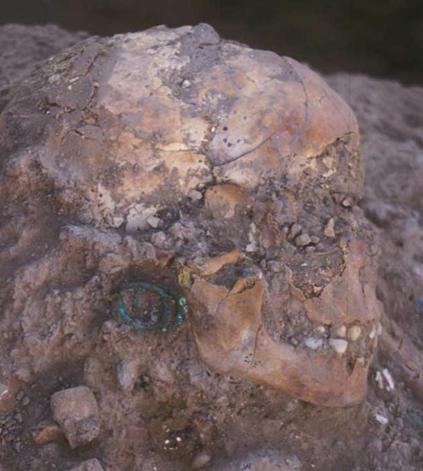 The 3,800-year-old burial of an aristocratic young girl adorned with bronze jewelry and Egyptian scarabs shows century-long links between Jericho and Egypt.