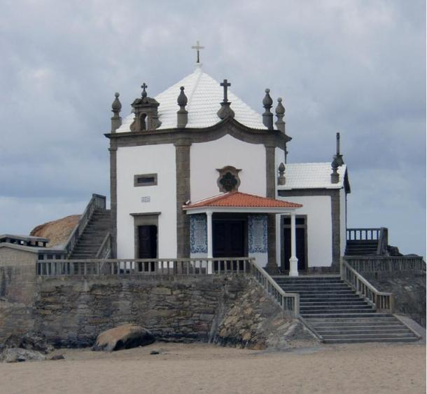 The Capela do Senhor da Pedra sits in a precarious position on the Atlantic Ocean front