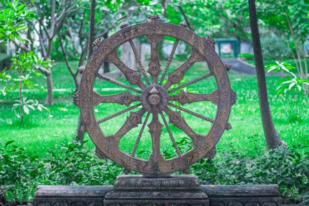 The Dharmachakra sometimes resembles a chariot wheel (TWiRote / Adobe Stock)