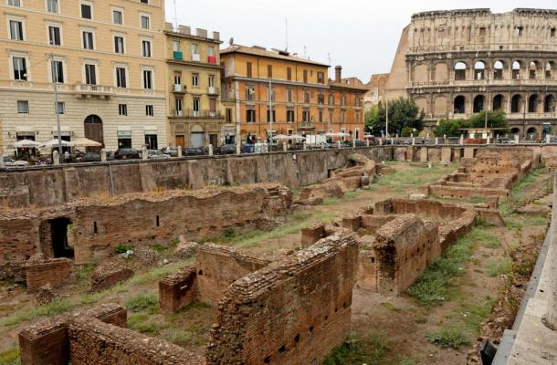 The Ludus magnus in Rome: barracks for gladiators built by Emperor Domitian (81–96 CE), view from Via Labicana. In the background, the Colosseum.
