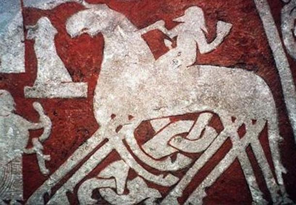 The Norse god Odin on his horse Sleipnir, featured on the Tjängvide image stone in Vallhalla. (Public Domain)
