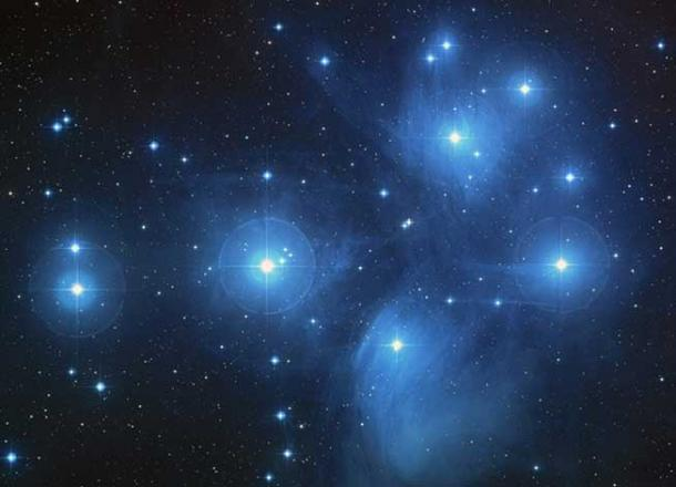 """The Pleiades, an open cluster consisting of approximately 3,000 stars at a distance of 400 light-years (120 parsecs) from Earth in the constellation of Taurus. It is also known as """"The Seven Sisters"""", or the astronomical designations NGC 1432/35 and M45."""