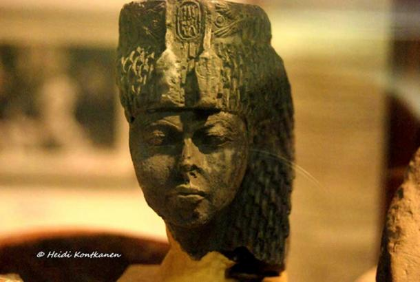 The astute and stern matriarch: Small greenstone head identified as Queen Tiye by her cartouches and distinctive uraei headdress. Found by Flinders Petrie in Sinai. Egyptian Museum, Cairo.