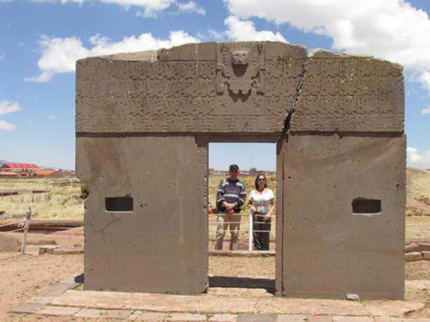 The author (left) at Tiwanaku in Bolivia with Sun Gate depicting Viracocha
