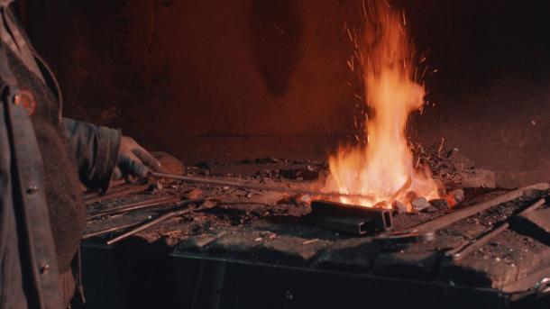 The blacksmith with a red-hot poker. (Chudakov / Adobe)