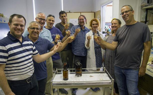 The brave team tasting the biblical-style beer produced from ancient yeast strains dormant for thousands of years. Yaniv Berman/ Courtesy of the Israel Antiquities Authority
