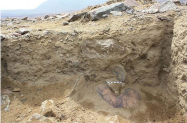 The cauldron was discovered on its side at Wasi Huachuma. (Guy S. Duke)
