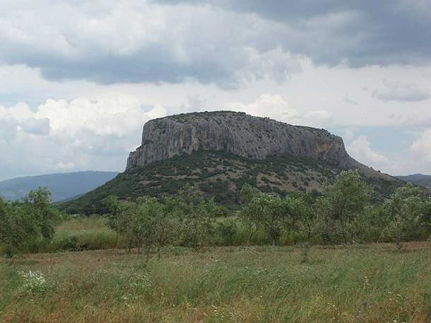 The cave is located on the slopes of a limestone hill overlooking Theopetra village.