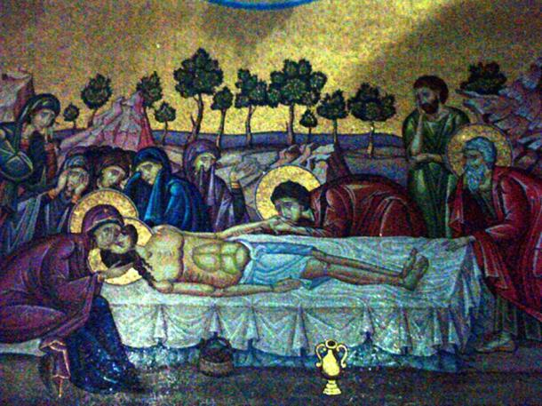The central part of a mosaic in the Church of the Holy Sepulchre in Jerusalem, on the outer wall of the Catholicon behind the Stone of Unction. The mosaic depicts Jesus being taken down from the cross, and his body being anointed prior to placing in the tomb.