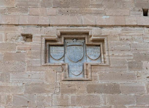 The coat-of-arms of the Lusignans of Cyprus. The emblem of Jerusalem, the old Lusignan coat of arms, the emblem of Cyprus, and the emblem of Armenia are represented. The four compartments exhibit unity, since as of 1393, the king of Cyprus was also king of Jerusalem and Armenia.