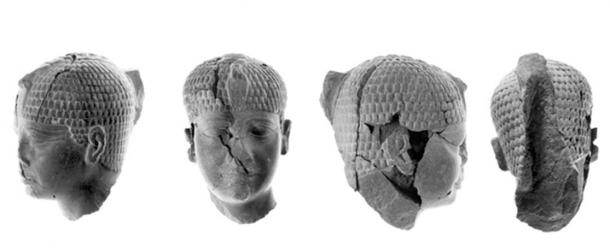 The cracks in the sculpture of the pharaoh's head are apparent in these photos.