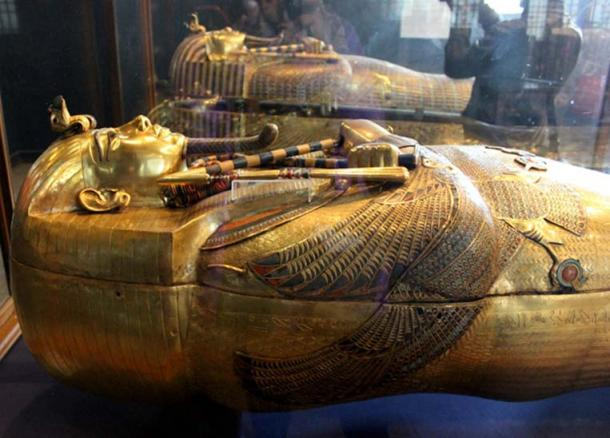 (Foreground) The dazzling, solid gold innermost coffin of King Tutankhamun and (Background) the middle coffin; from a nest of three. As Treasurer, Maya was in charge of assembling funerary goods destined for KV62. Egyptian Museum, Cairo.