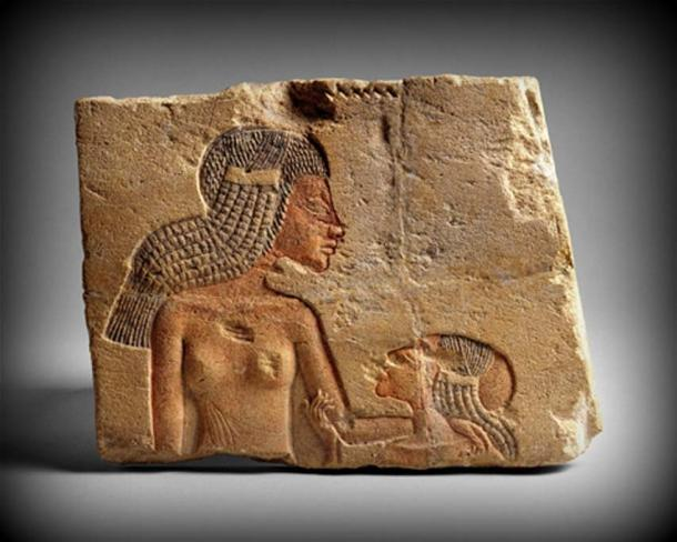 The demonstration of affection in this detail showing two of Akhenaten's daughters – probably Meritaten and Ankhesenamun – is typical of the intimacy allowed in representations of the royal family during the Amarna period.