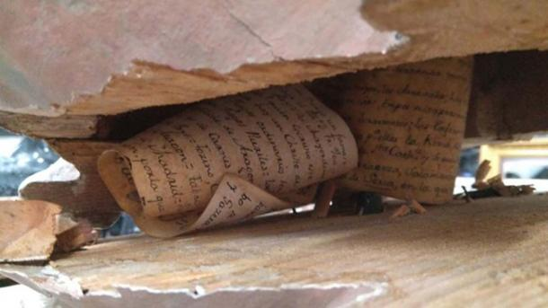 The document was found hidden under the wooden loin cloth of the statue.