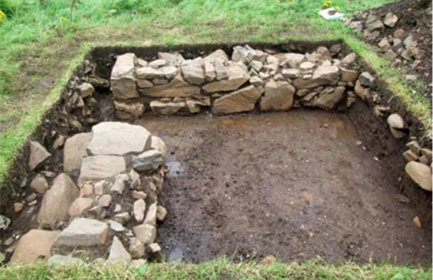 The excavated home with the doorway in the corner.