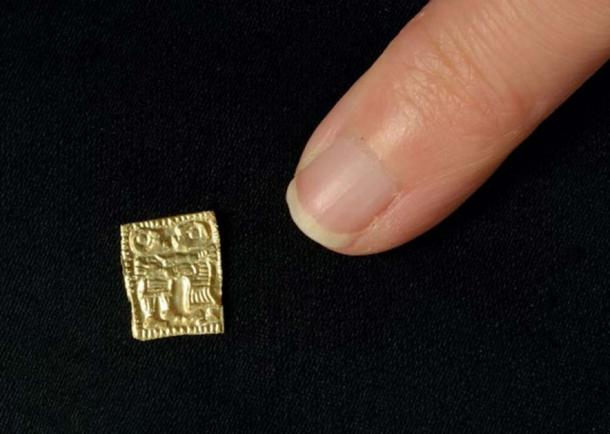 The gold amulets are extremely tiny, like the size of the little finger nail. (Photo: Vegard Vike and Jessica McGraw / Museum of Cultural History, Oslo)