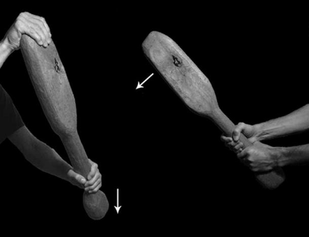 The hand positions used to administer the two types of blow: left) the pommel strike; right) the double-handed strike. Arrows indicate direction of swing.