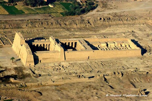 The imposing Mortuary Temple of Ramesses III at Medinet Habu. The pharaoh used this structure as his royal palace and later converted it into a war memorial in order to commemorate his victory over the Sea Peoples and Libyans. This image was shot during an aerial survey of the West Bank in 2010.