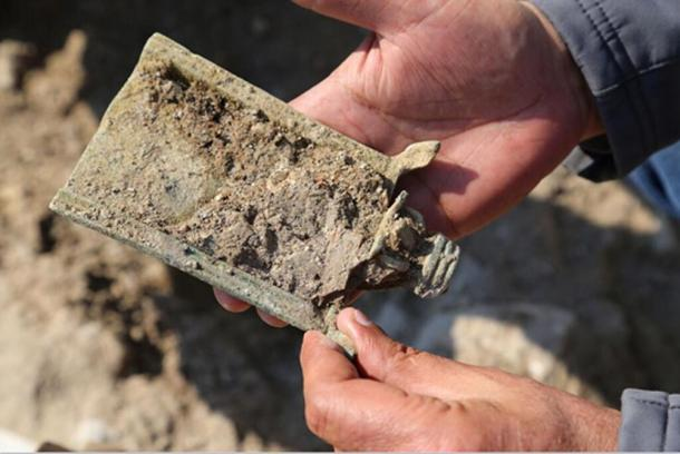 The incense shovel as it was found in the excavation.