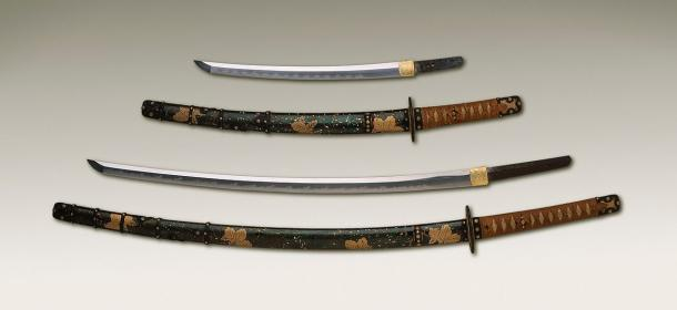 The larger katana sword here is illegal in the UK. The shorter (less than 50cm) blades are not. (Public Domain)