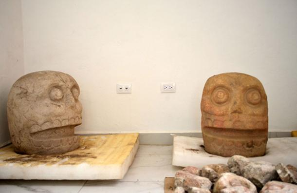 The noses of the sculpted heads are cut, representing sacrificial victims. (Image: Melitón Tapia, INAH)