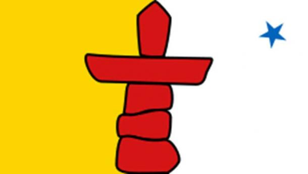 The official flag of Nunavut features a red inuksuk and a blue star, which represents the Niqirtsuituq, the North Star. Public Domain.