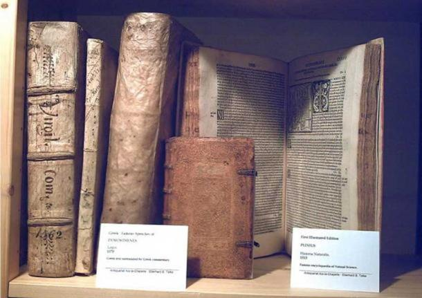 The oldest illustrated version (1513) of the Historia Naturalis of Plinius maior (right). Also showing a 1570 edition of the famous Greek speeches, the Logoi by Demosthenes.