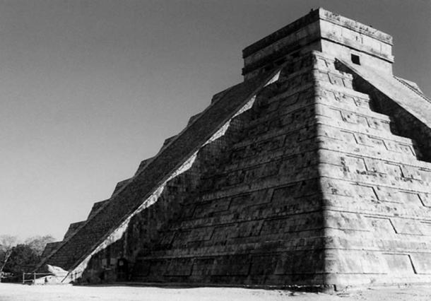 Fig 1. The pyramid of the Plumed Serpent at Chichen-Itza. Note the seven triangles of light projected onto the staircase as scales on the back of the plumed serpent that descends into the earth. (photo by Carl Calleman)