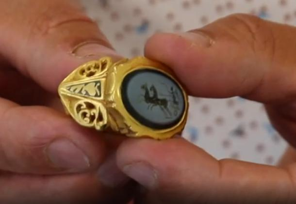 The ring is large and of solid gold with an onyx stone engraved with the god 'Victory'. (Image: BBC Somerset)