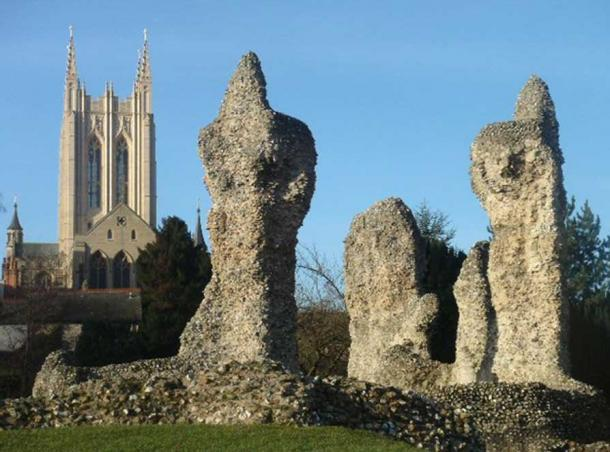 The ruins of the Abbey of St. Edmund with the more recent cathedral in the background.