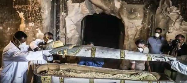 The sarcophagus containing the female mummy being opened. (Youtube Screenshot)