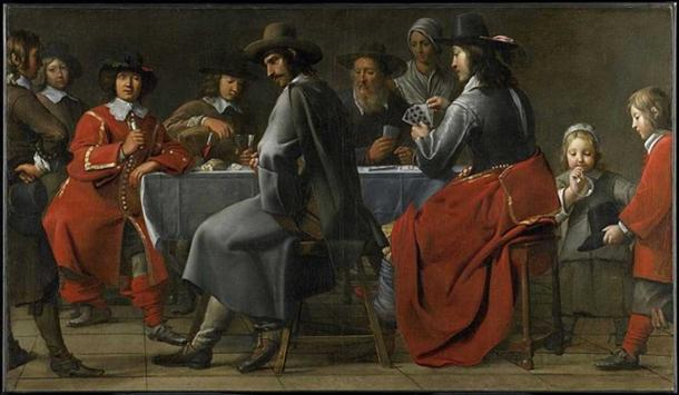The small hurdy gurdy is barely visible under the arm and cloak of the player in this 17th Century painting.  Gathering of Gamblers with Hurdy-Gurdy Player circa 1660.