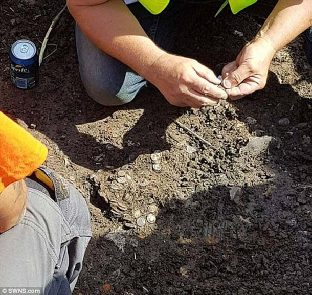 The stash of over 600 coins were found during an organised metal detector hunt in Bridport, Dorset, UK