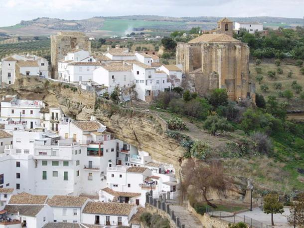 The surrounding rock cliffs of Setenil de las Bodegas served as a natural defense system during the Christian Reconquista.