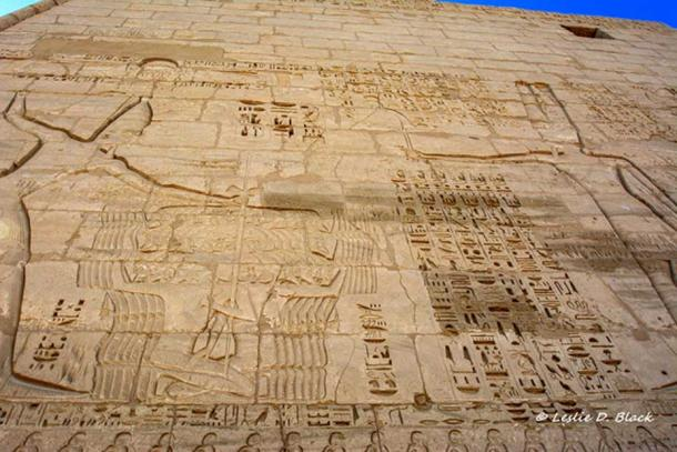 The texts beside this scene of Pharaoh Ramesses III smiting his enemies are carved deep into the wall to avoid usurpation at a later date. Mortuary Temple of Ramesses III. Medinet Habu.