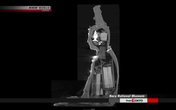 The whole body and head of the statue can be seen to contain artifacts. How they were placed there is as yet undetermined. (Image: NHK Newsline Screenshot)