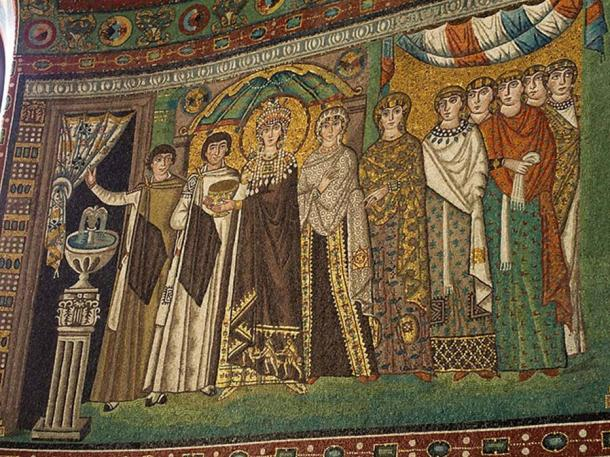 Theodora with her court; she is holding the chalice which held the wine that was thought to be transubstantiated into the blood of Christ. On the mosaic showing Justinian, he is holding a vessel in which would be the bread or body of Christ. (Ruge/CC BY SA 4.0)