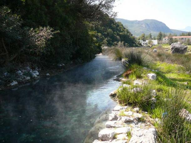 Thermopylae derives half of its name from its hot springs. This river is formed by the steaming water which smells of sulfur. In the background, you can see buildings of the modern baths. In ancient times, the springs created a swamp.
