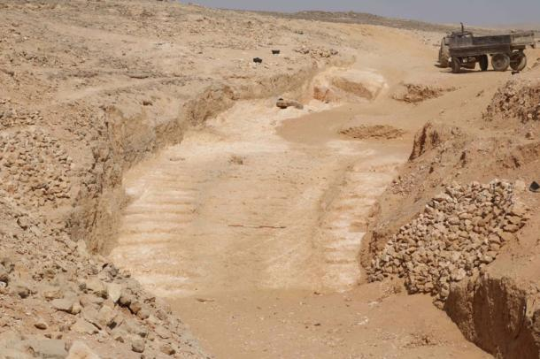 This 4,500-year-old ramp was discovered at Hatnub, an ancient quarry in the Eastern Desert of Egypt. Two staircases with numerous postholes are located next to the ramp. An alabaster block would have been placed on a sled, which was tied by ropes to the wooden poles. (Yannis Gourdon/Ifao)