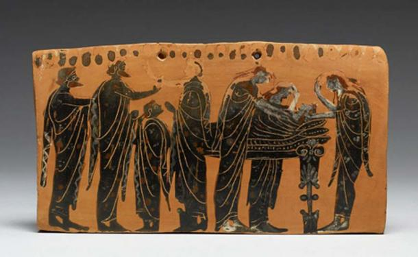 """This black-figure example shows a """"prothesis"""" scene, the lying-in-state of the deceased on a bed, surrounded by his family members, some of whom tear their hair in mourning. (Public Domain)"""